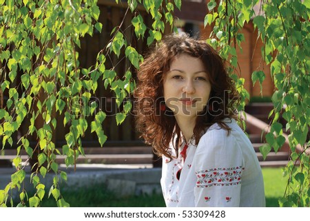 Female portrait of ukrainian girl looking us. Spring time - stock photo