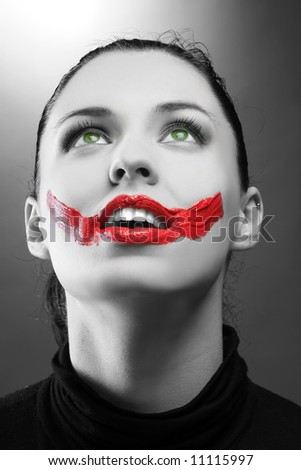 female portrait with red paint on lips - stock photo