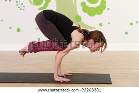 Female practicing yoga - stock photo