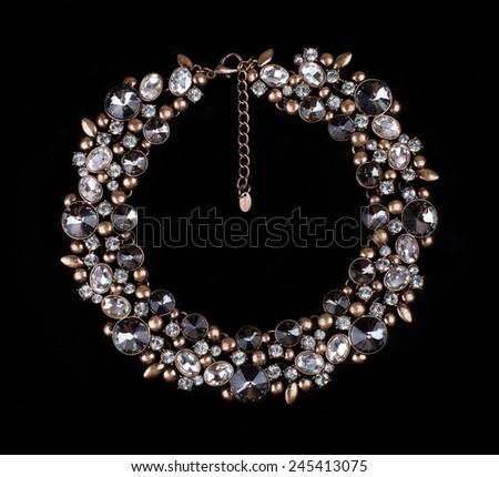 female precious decoration on black background - stock photo