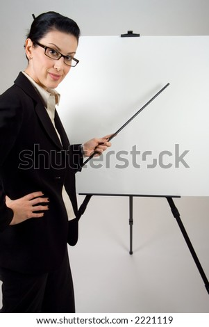 Female presenter with blank presentation whiteboard - stock photo