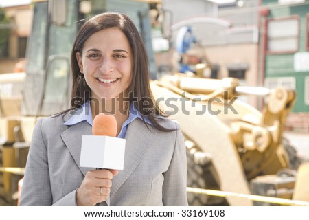 female professional reporting from a construction site - stock photo