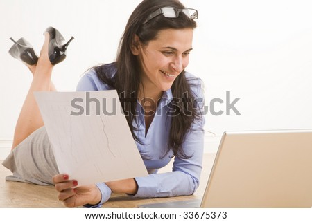 female professional sitting in casual position with laptop