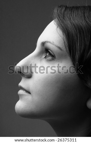 Female profile. Beautiful young woman close up.