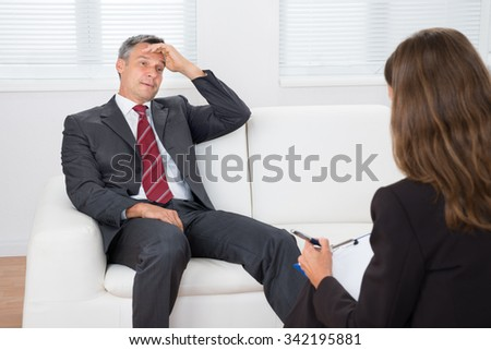 Female Psychiatrist Listening About Problem Of Depressed Patient - stock photo