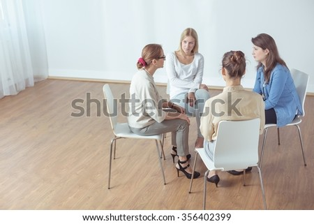 Female psychotherapist with support group during classes