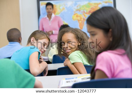 Female pupil being bullied in elementary school - stock photo