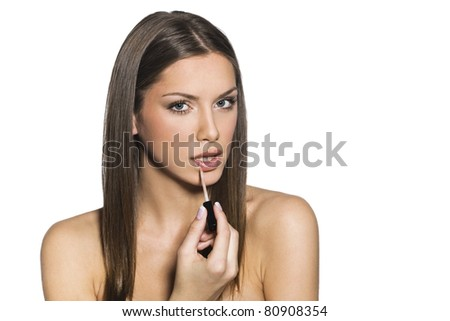 female putting make-up - stock photo