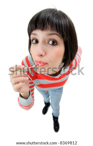 Female putting on make-up - stock photo