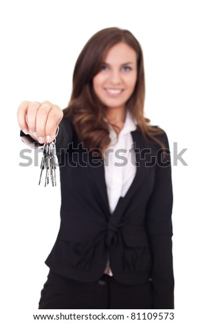 female real estate agent giving a home buyer the keys, isolated on white background - stock photo