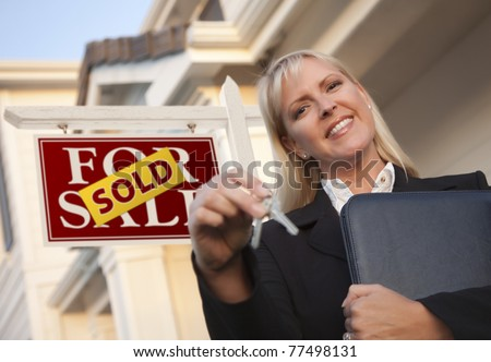 Female Real Estate Agent with Keys in Front of Sold Sign and Beautiful House. - stock photo