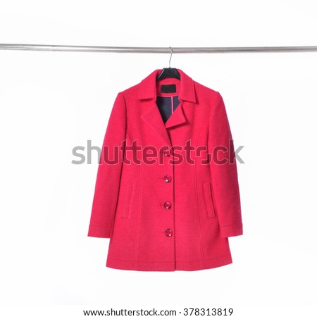 Female red coat clothing on hanging - stock photo