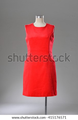 female red dress on dummy-gray background   - stock photo