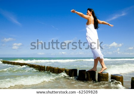 Female relaxing on coast growing success balance - stock photo