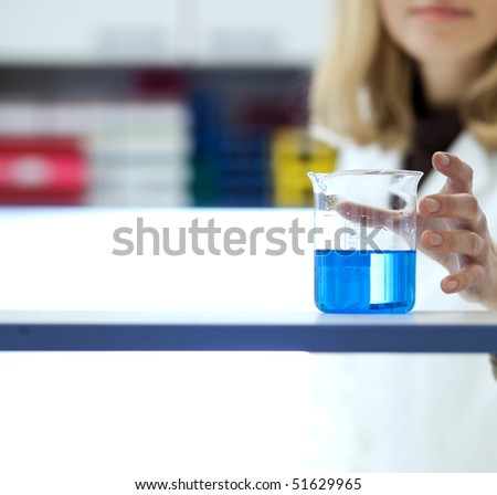 female researcher carrying out research/experiments in a chemistry lab