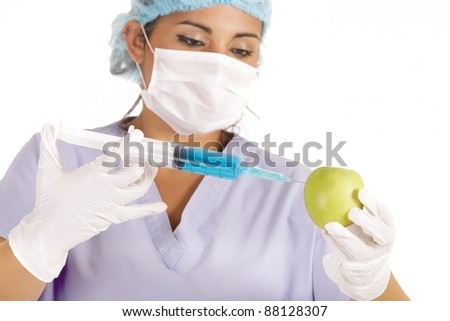 female researcher injecting liquid in green apple - stock photo