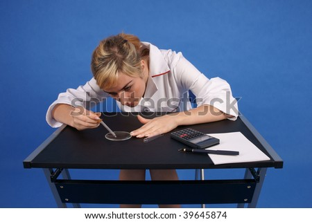 Female researcher working - stock photo