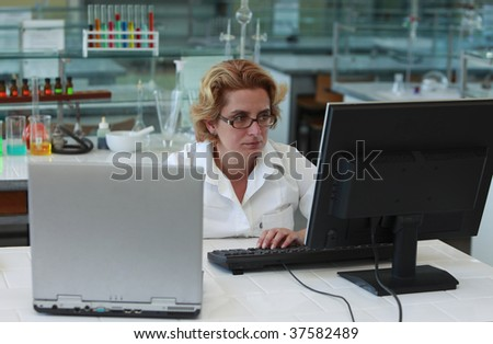 Female researchers working on computers in a laboratory. - stock photo