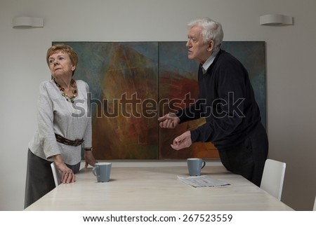 Female retiree being offended at her husband - stock photo