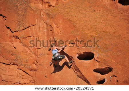 Female Rock Climber at Garden of the Gods - stock photo