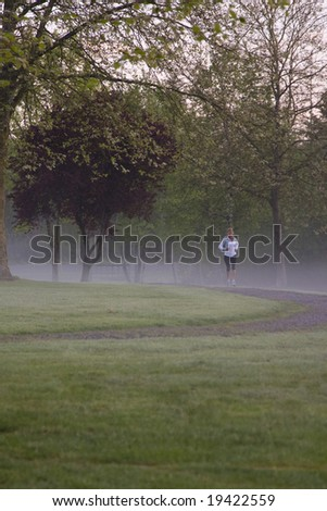 Female runner at sunrise. - stock photo