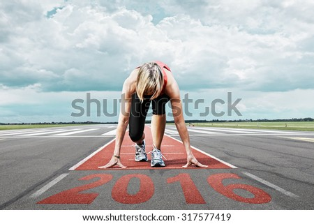 Female runner waits for the start on an airport runway. In the foreground perspective view of the  date 2016. - stock photo