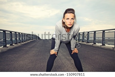 Female runner with focus and determination to run - stock photo