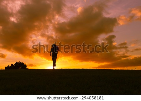 Female running during sunset.
