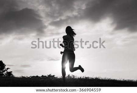 Female running in the park.  - stock photo