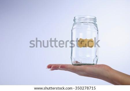 female's hand holding a empty jar - stock photo