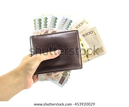 female's hand holding 1000 banknotes in brown leather wallet isolated on white background, Thai money - stock photo