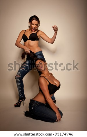 Female Sadomasochistic Relationship with the dominatrix pulling the hair and shouting at her female partner - stock photo