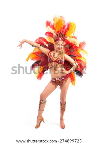 Female samba dancer posing in a colorful costume - stock photo