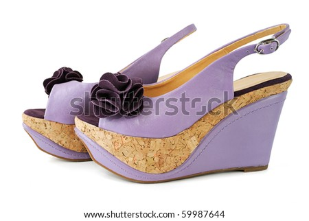 Female sandals on a high heels isolated on white background - stock photo