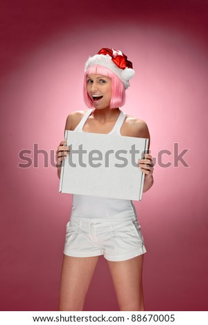 Female santa holding a christmas white box over red background - stock photo