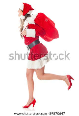 Female Santa running with a gift sack on Christmas day ? isolated