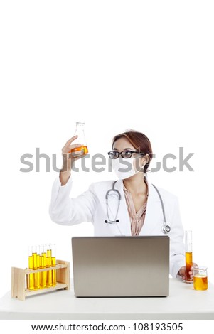 Female scientist looking the reaction result at reaction tube. shot in laboratory - stock photo