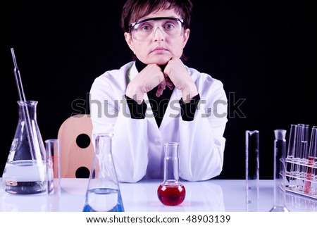 Female Scientist Portrait between flasks and fluids in lab