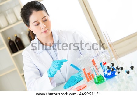 female scientist researcher observing a colour shift in laboratory