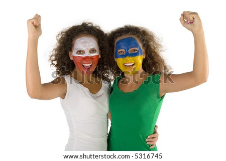 Female screaming fans with hands up and painted Polish and  Slovakian flags on faces. They're looking at camera. They're on white background. Front view. - stock photo