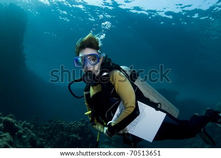 Female scuba diver during an advanced open water course in the Southern Red Sea - stock photo