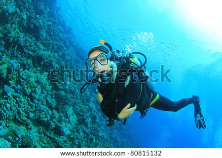 Female Scuba Diver on Coral Reef - stock photo
