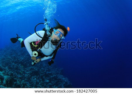 Female Scuba Diver underwater - stock photo