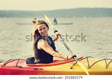 Female Sea Kayaker. filtered color - stock photo
