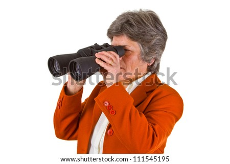 Female senior business woman with binoculars looking to the future
