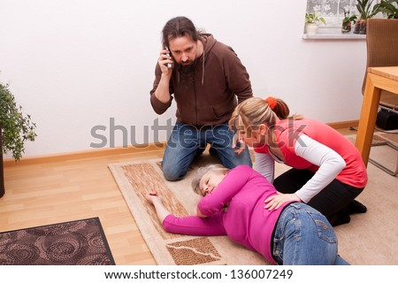 female senior is unconscious, childs calling  rescue service - stock photo