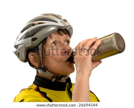 FEMALE SENIOR THIRSTY AFTER A BIKE RIDE! - stock photo
