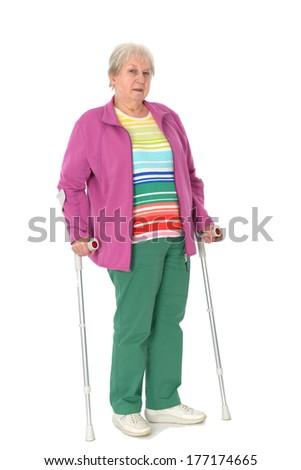 female senior with crutches - stock photo