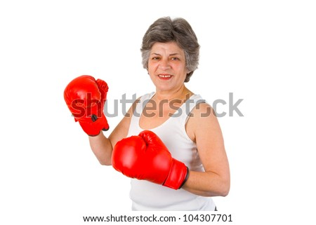 Female senior with red box gloves - isolated on white backgroound - stock photo