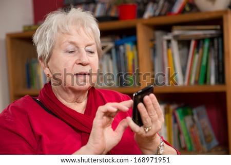 female senior with smartphone - stock photo